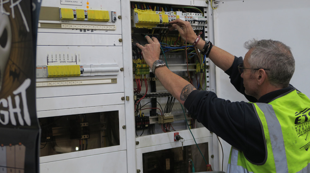 Electrical Testing Surveyor testing on an electrical installation