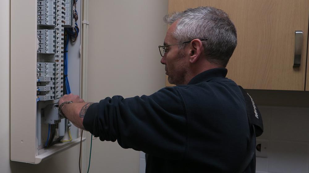 Electrical Testing Surveyor checking electrical circuit box
